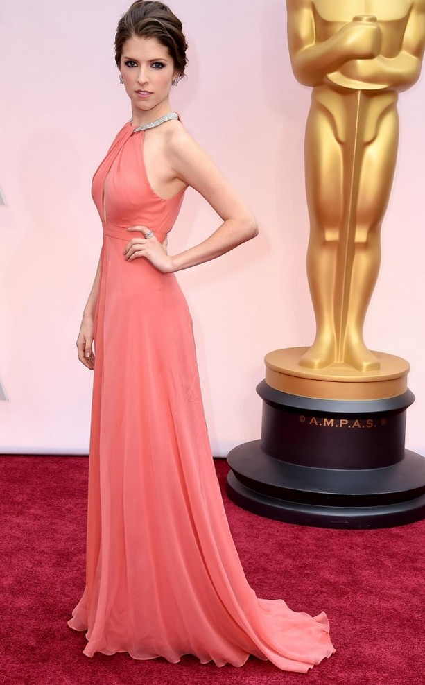 Anna Kendrick was wearing a coral Thakoon gown featuring a jeweled collar and Norman Silverman jewelry
