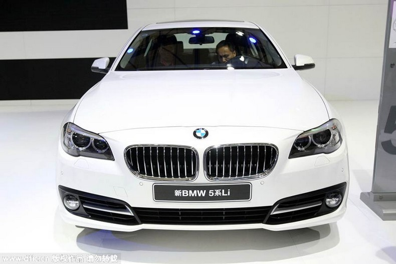 Visitors Try Out A BMW 5 Series Li During The 2014 Pudong International  Automotive Exhibition In Shanghai, China