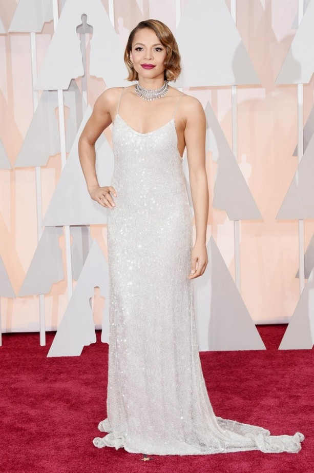 Carmen Ejogo wore a white sequined gown from Houghton Bride's spring/summer 2015 runway