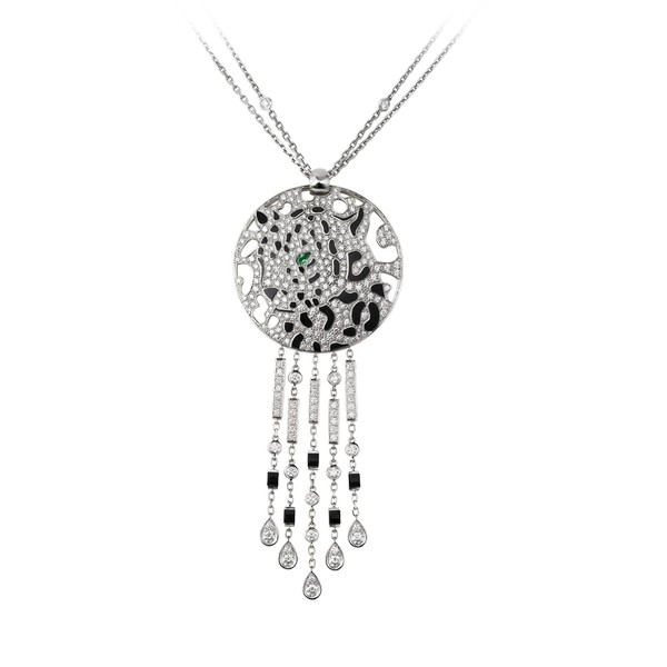 18K white gold necklace with a panther-decor pendant. Pendant set with diamonds, one emerald eye and black lacquer spots. Sticks set with onyx and diamonds. Presented on a double chain set with diamonds, hook clasp. Necklace length: 45 cm. Pendant dimensions: 3.8 cm in diameter, 5.2 cm taller stick length.