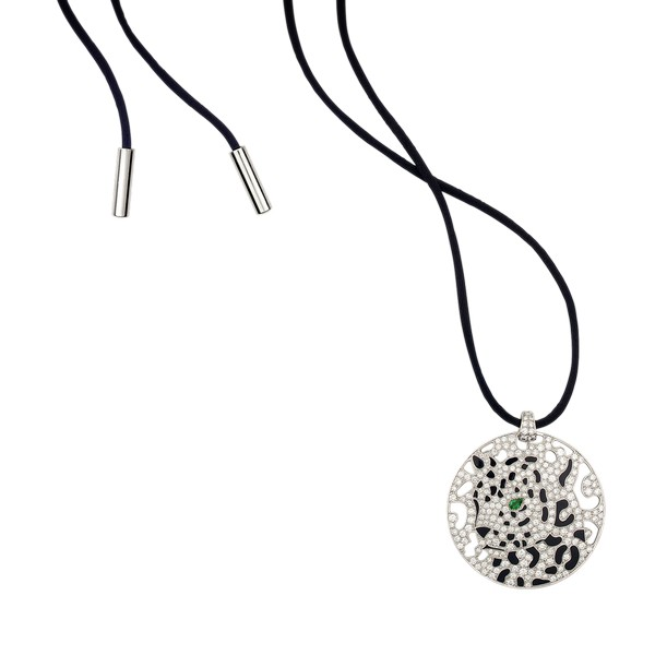 18K white gold pendant set with diamonds, emerald, onyx, black lacquer, openworked spots, on a 80 cm long black cord.