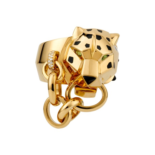 Ring in 18K yellow gold with panther head motif, diamonds, onyx nose and cones, black lacquer spots, tsavorite-garnet eyes.