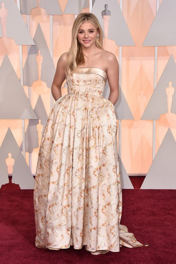 Chloë Grace Moretz was wearing a strapless floral pleated Miu Miu gown and a sparkling diamond earcuff