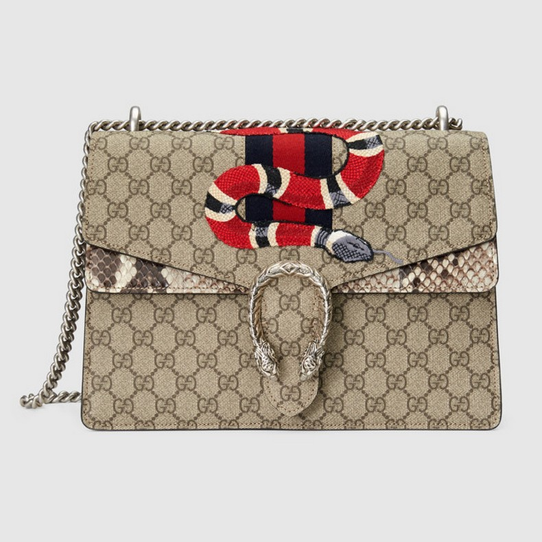 This shoulder bag has a textured tiger head spur closure with snake and signature web embroidery. The sliding chain strap can be worn multiple ways, changing between a shoulder and a top handle bag.