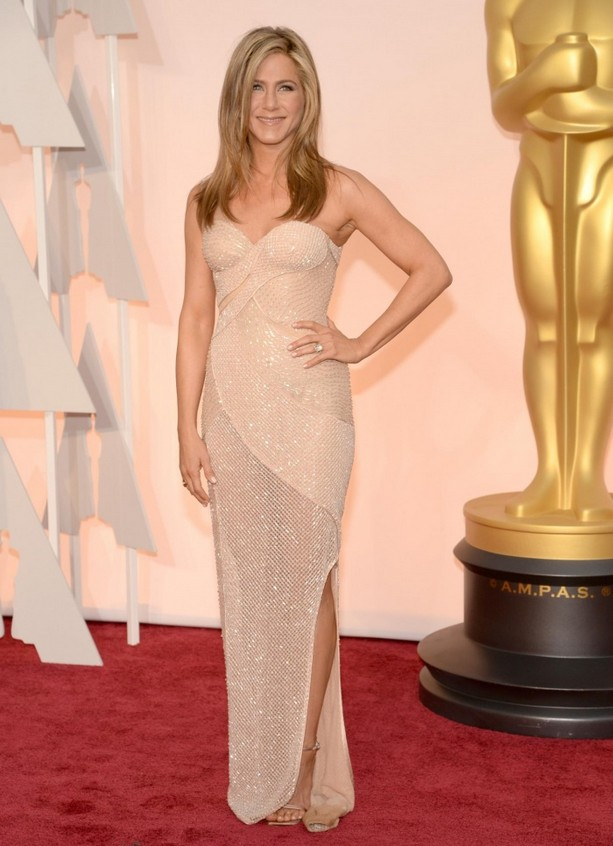 Jennifer Aniston was wearing a beige Versace dress and Fred Leighton jewelry