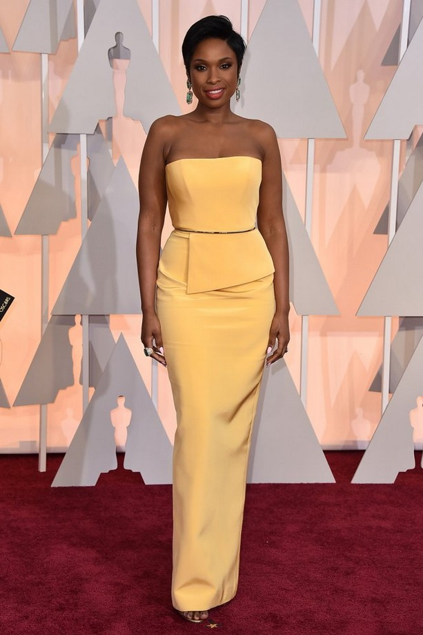 Jennifer Hudson was wearing a strapless yellow Romona Keveza gown, accented with green statement earrings