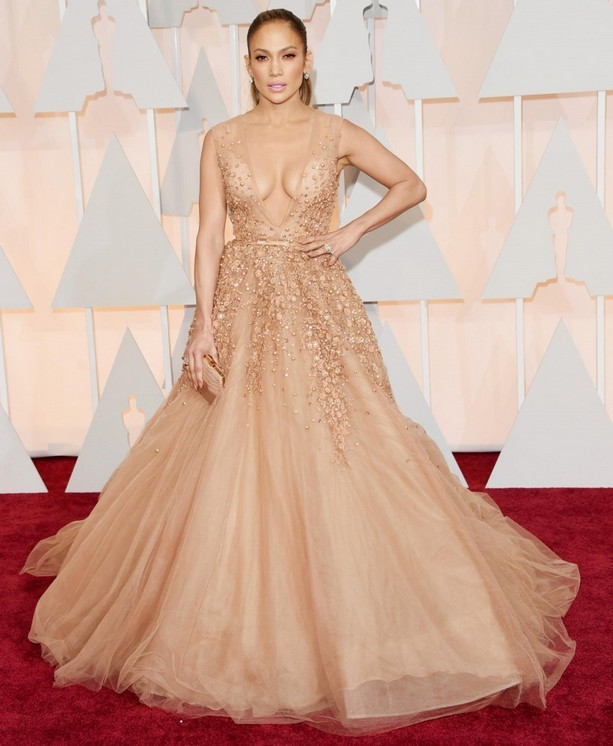 Jennifer Lopez was wearing a stunning Elie Saab blush-colored gown with a full skirt