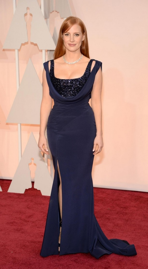 Jessica Chastain was wearing a floor-length navy Givenchy dress and shoes with Piaget jewels