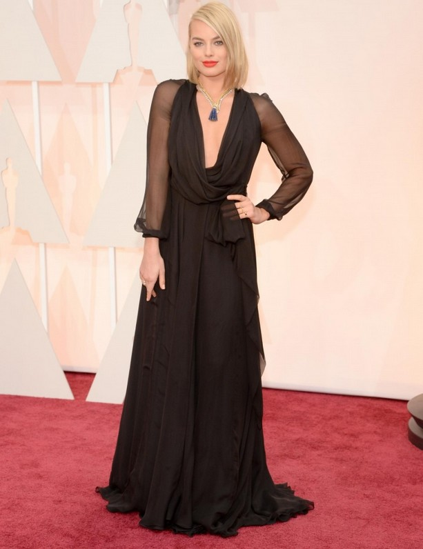 Margot Robbie was wearing a plunging, sheer-sleeve Saint Laurent gown and vintage Van Cleef & Arpels necklace