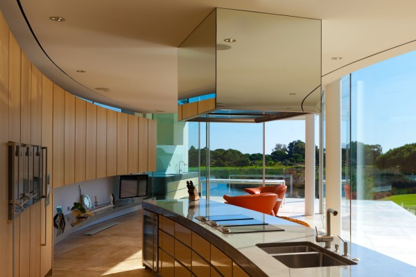 Posh portuguese residence with beautiful lake views 4 curved kitchen 600x400