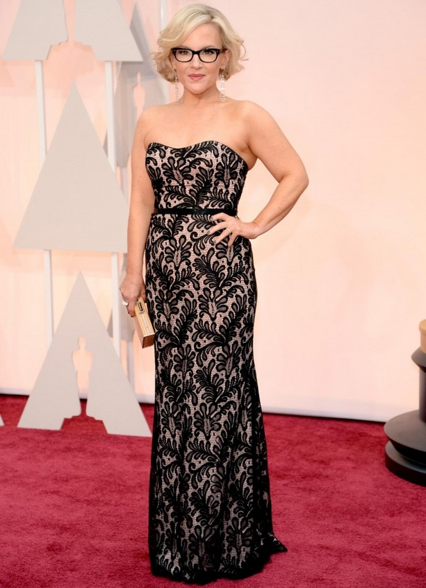 Rachael Harris was wearing a lace black and nude gown, coupled with a gold clutch and black framed glasses