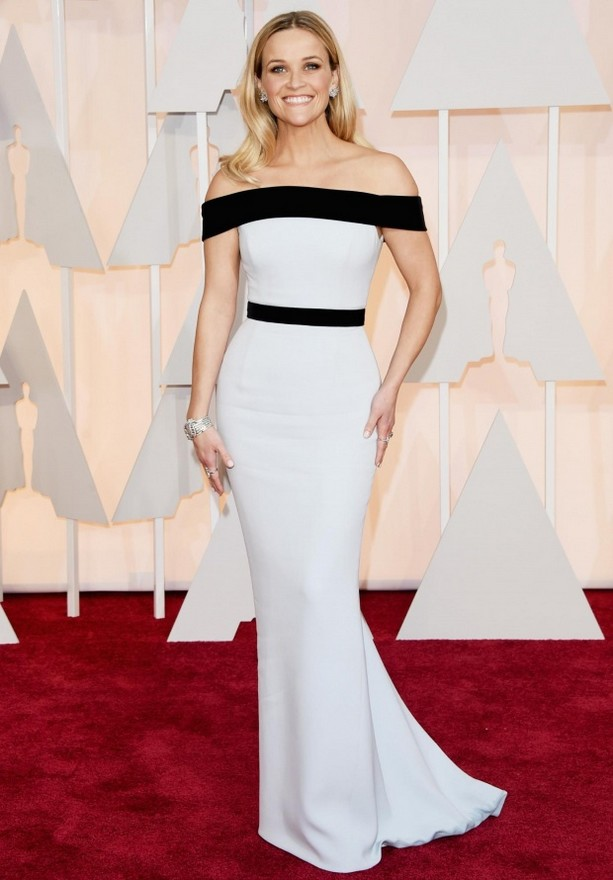 Reese Witherspoon was wearing a white Tom Ford column dress with two black strips of fabric at the horizontal off-the-shoulder neckline and waist