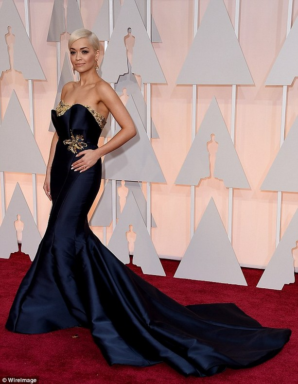 Rita Ora was wearing a navy Marchesa fishtail gown with long train