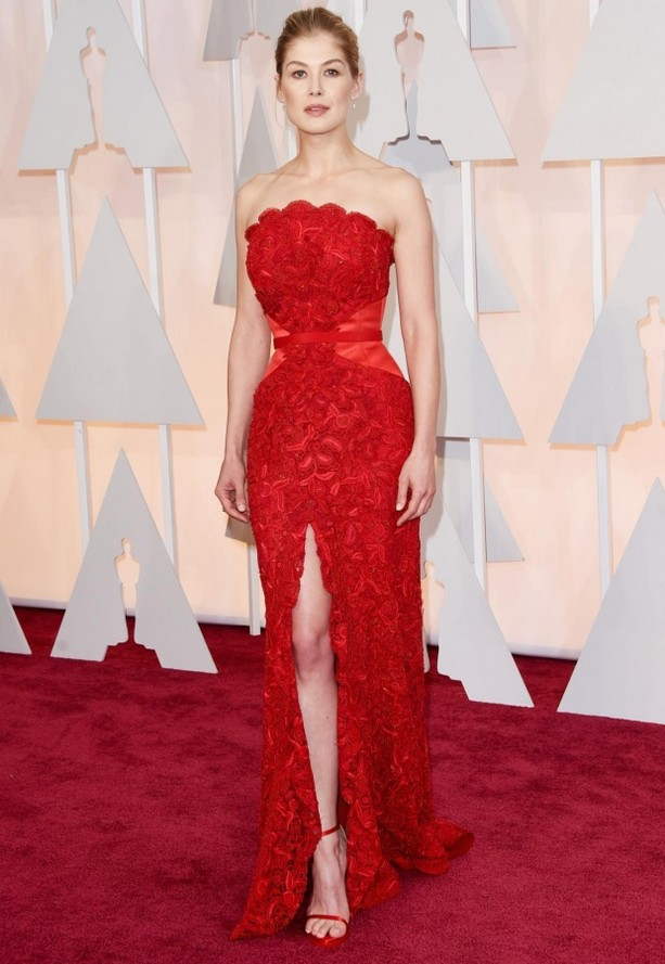 Rosamund Pike was wearing a flower embellished red dress with thigh split from Givenchy