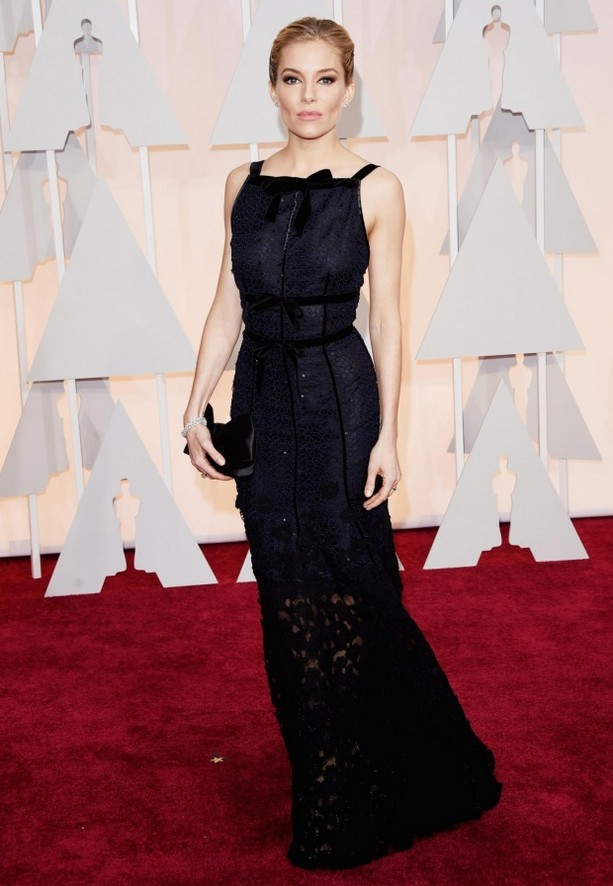 Sienna Miller was wearing a black and navy Oscar de la Renta gown with velvet bow details
