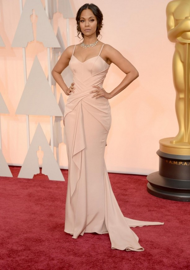 Zoe Saldana was wearing a blush-colored body-hugging Atelier Versace gown and a bright diamond statement necklace