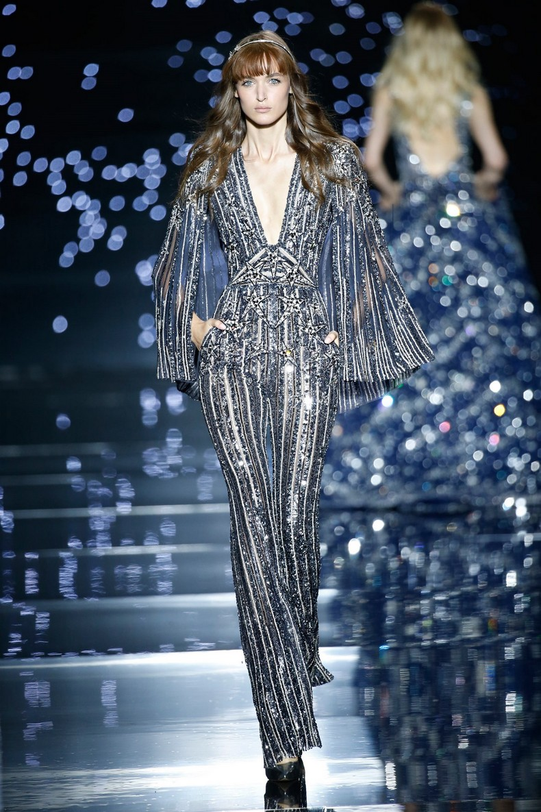 Zuhair Murad Haute Couture FW 2016 - Fitted silk tulle jumpsuit with cape sleeves, embroidered with trails of silver and anthracite stars