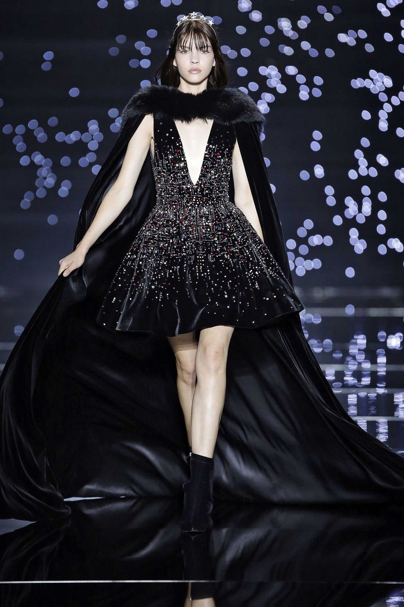Zuhair Murad Haute Couture FW 2016 - Long black silk tulle cape with fox collar, worn on a silk velvet dress with plunging neckline and crystal constellations