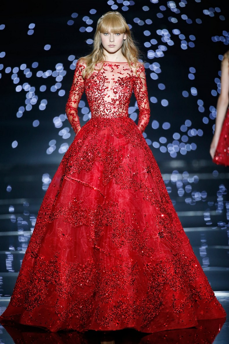 Zuhair Murad Haute Couture FW 2016 - Long flared dress in fire red tulle, dotted with a rainfall of comets