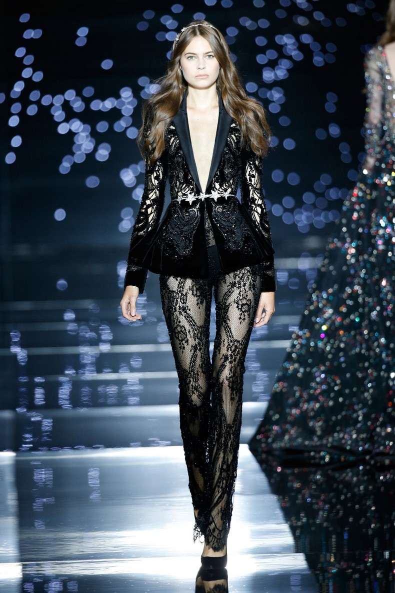 Zuhair Murad Haute Couture FW 2016 - Perforated black silk velvet tuxedo jacket, embellished with star-like crystals and worn with a fitted black Chantilly lace jumpsuit