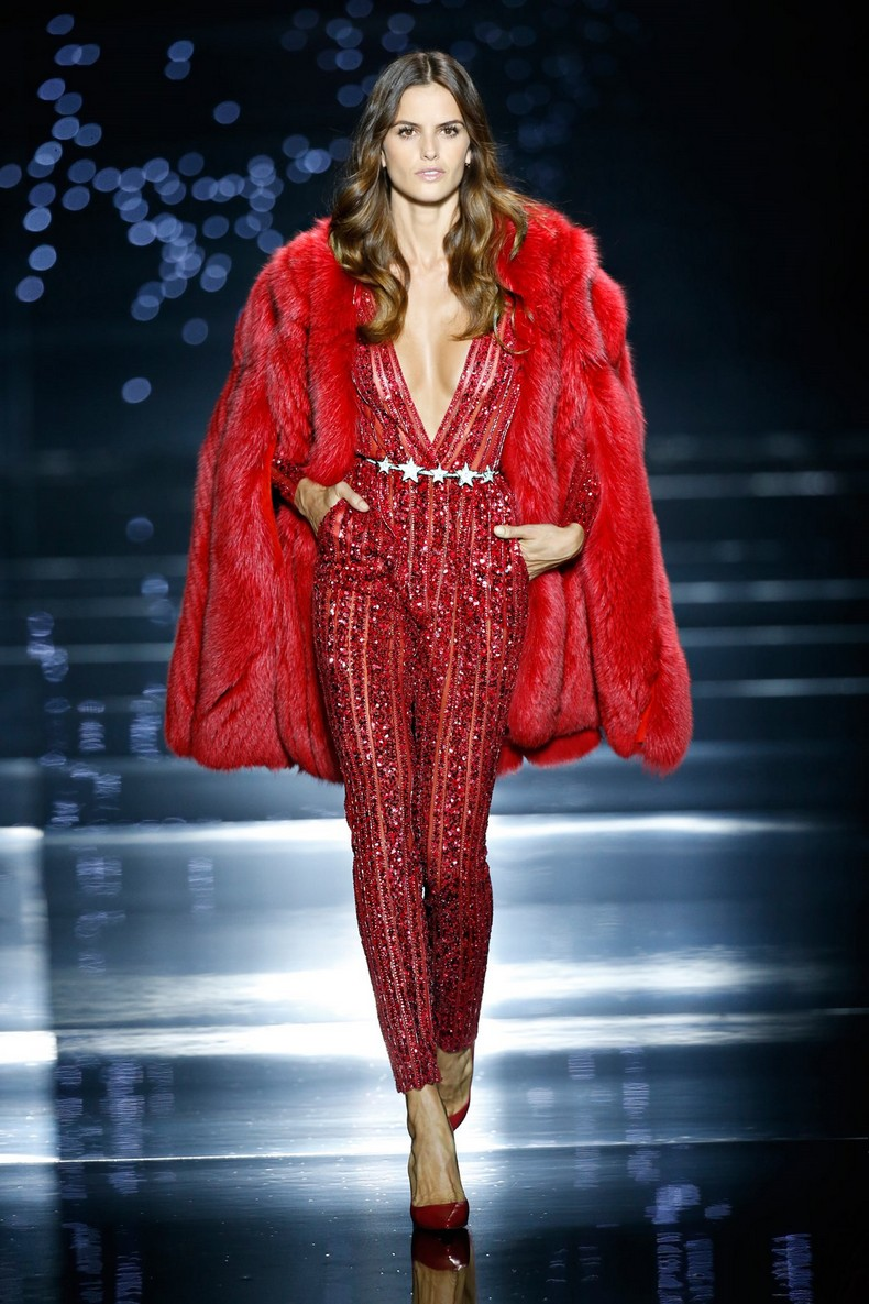 Zuhair Murad Haute Couture FW 2016 - Red fox fur coat worn with a fire-red stone and sequin embellished silk tulle striped jumpsuit with plunging neckline