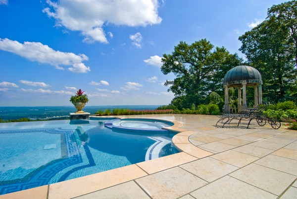 luxury-vanishing-edge-pool-with-glass-tile-inlay-ideas-nj